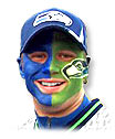 Seahawks fan painted with the team colors and logo.